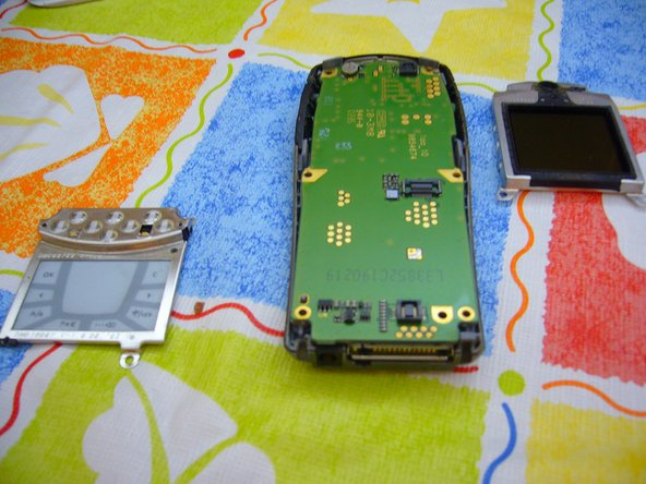 After removing the touch pad and the screen.You can remove the logic board from the case.
