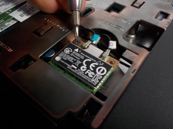 Gently remove the wifi chip from its socket and place it to the side.