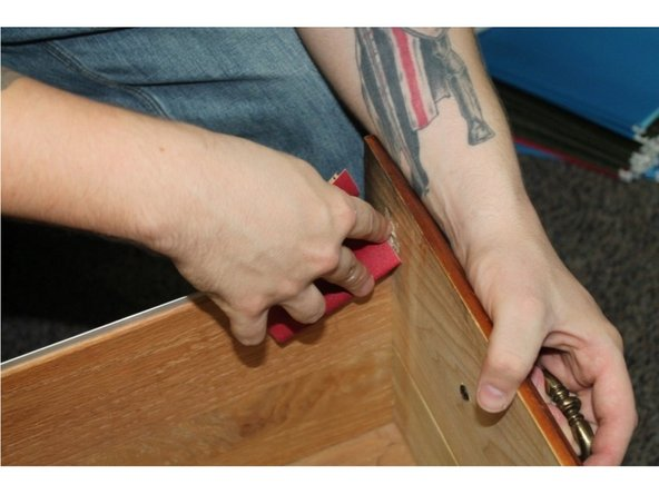 Use the sandpaper and the wood file to sand the area until it is completely smooth to the touch.