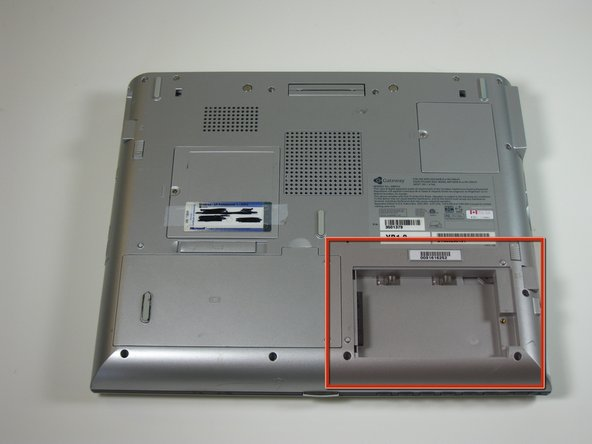 Image 1/1: slide hard drive to the right and remove.