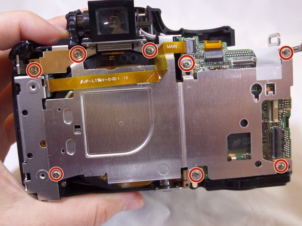 Use a Phillips screwdriver to remove the ten  3.175 mm screws on the inside of the camera.