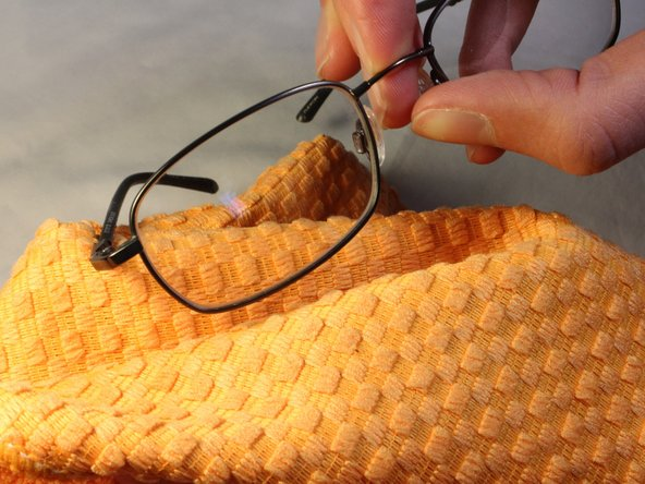 Image 3/3: To dry off glasses and remove any remaining wax on the lenses, wipe them off using a clean cloth.