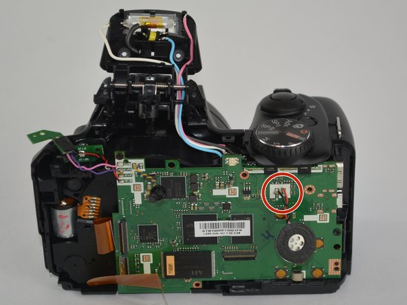 Image 1/3: Identify where the speaker is connected to the motherboard and unsolder both of the connections,