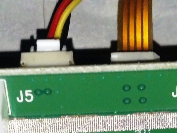 close up of the front upper right corner of the board sitting in it's mounting spot.