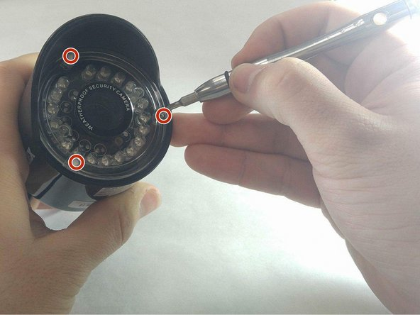 To remove the motor, you must begin by removing the three screw caps and the 15mm JIS 0 screws associated with them located on the plastic containment shell that the camera is  in.