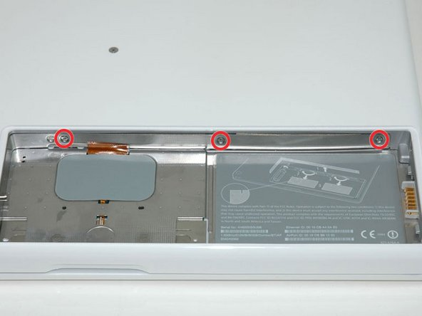 Remove the three evenly-spaced Phillips screws from along the rear wall of the battery compartment.