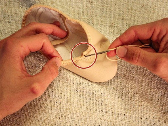 Rethread the shoe by putting the needle through one end and pushing it through to the other opening