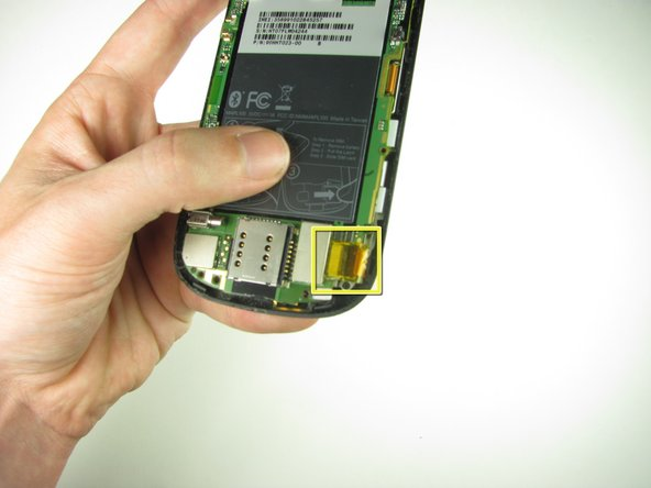Peel off the yellow piece of tape from the phone