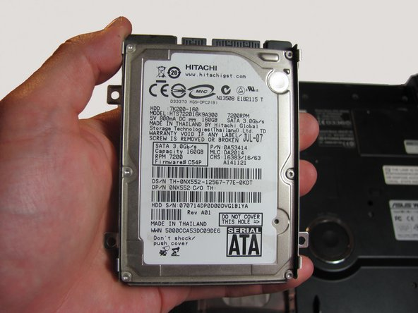 Lift the hard drive upwards to remove it from the laptop.