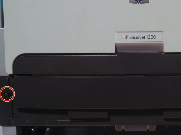 The cartridge door can be removed by removing 2 screws on the front of the printer.