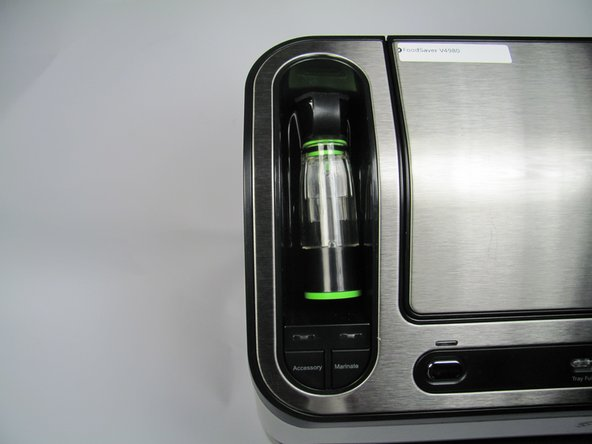 The liquid chamber accessory can be found on the top-left side of the appliance.