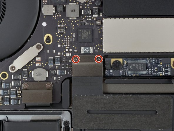 Use a T3 Torx driver to remove the two 1.8 mm screws securing the trackpad cable connector bracket.