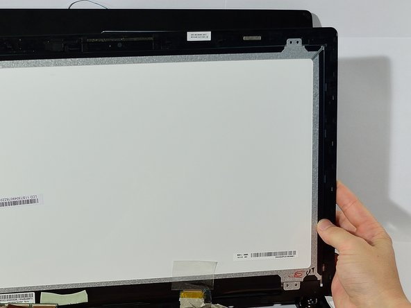 Slide LCD screen around the edges while pulling upwards so that it pops off.
