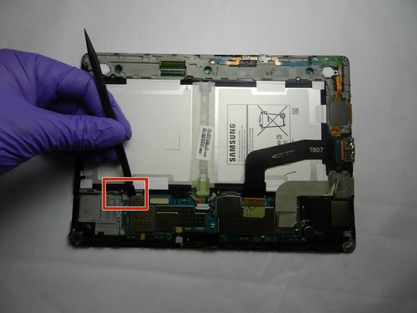 Disconnect the motherboard and remove it from the device using the spudger.