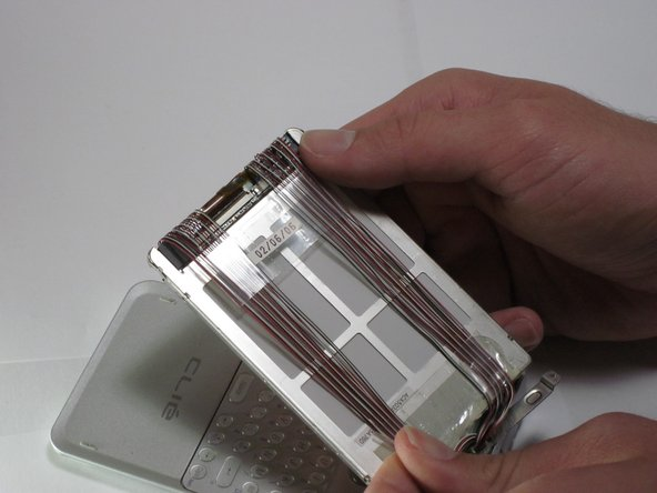 Remove the tape from the wires on the back side of the screen module.