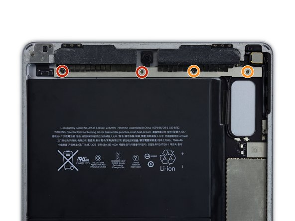 Remove the following four Phillips screws securing the upper component cable bracket to the tablet.
