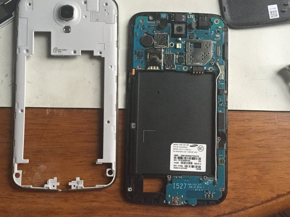 Image 3/3: Once the back frame has been removed, the motherboard and connectors will be exposed.