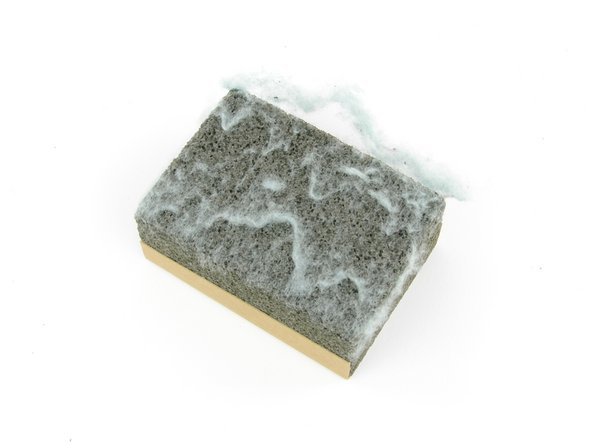 Clean your sweater stone by rubbing your hand across the stone to removing the lint.