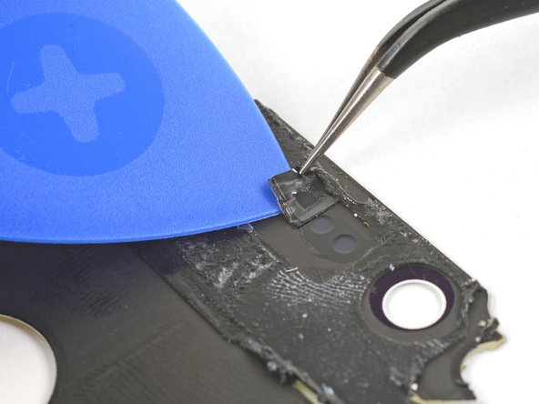 If your replacement rear glass does not come with a microphone mesh, you will have to transfer the original over.