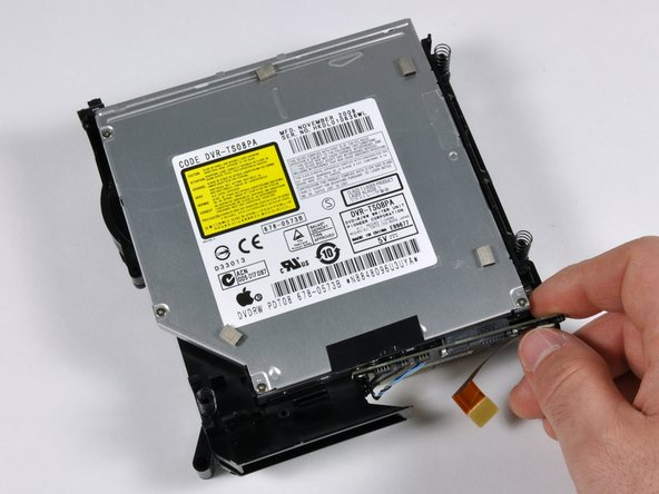 Remove the six Philips screws from the left, right, and back sides of the SuperDrive.