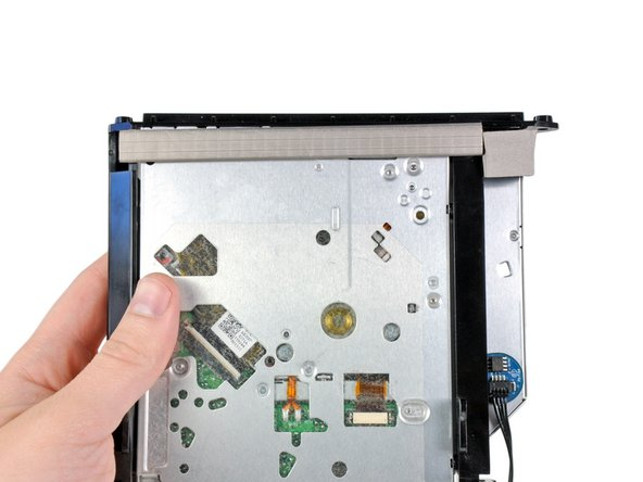 Use the flat end of a spudger to remove the pieces of EMI foam from the underside of the optical drive.