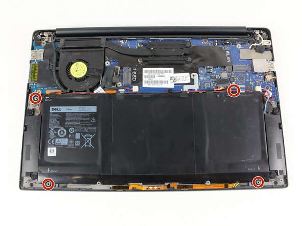Remove the four 3 mm Phillips #0 screws located on each corner of the battery.