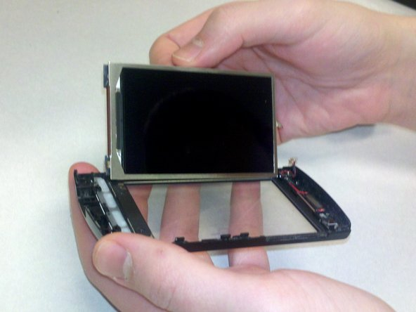 Image 2/2: The screen should come out with ease and be completely detached from the rest of the cover.