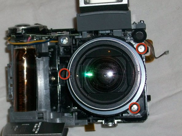 Image 1/1: Remove 3 screws holding barrel of lens to main frame of camera.