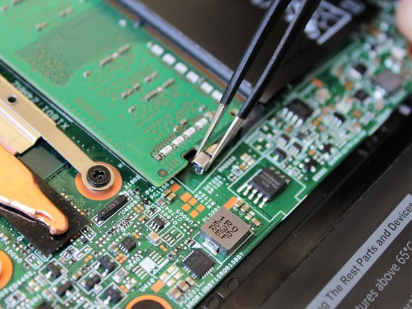 As before, pull the fasteners away from the chip with the tweezers.