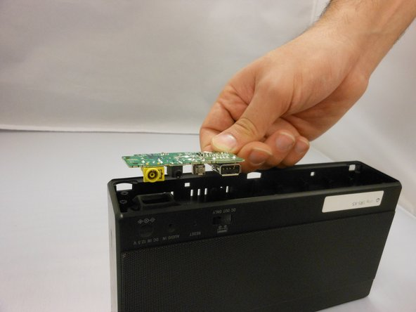 Remove the aux board. Be careful as the board might need some wiggling to get out.