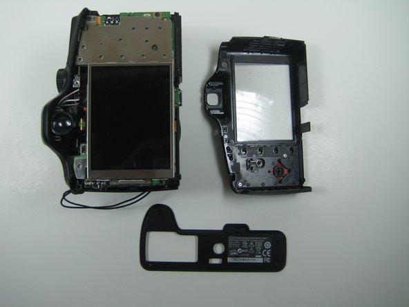 Once the back cover has been successfully removed, you should have a total of eleven screws as well as the bottom cover separated from the camera.