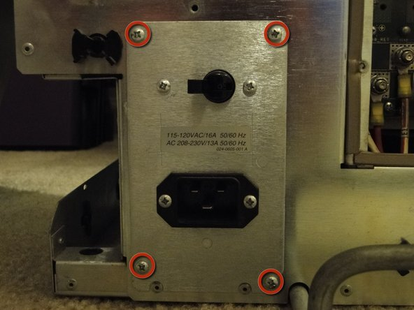 These screws hold in the circuit breaker and power receptacle assembly.