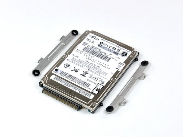 Image 1/1: Remove the hard drive brackets from the left and right sides of the hard drive.