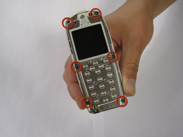 Once the keypad has been removed, unscrew the 6 exposed screws on the front of the phone.
