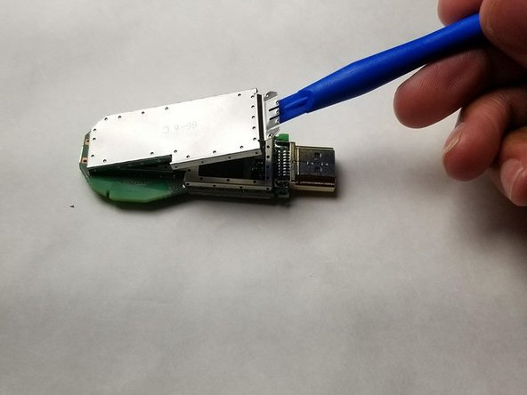Completely remove the top metal casing to expose the internal components.