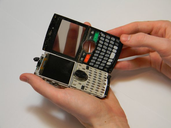 Image 2/2: Separate the front panel from the main body of the phone using your fingers.