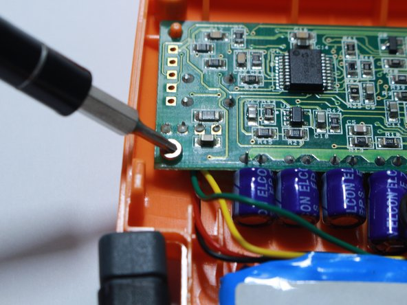 Using a T6 Torx screwdriver, unscrew the 5.66 mm screws attaching the circuit board to the case.