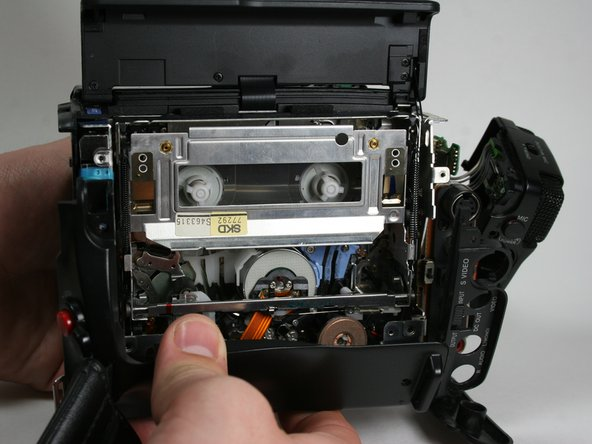 Pull the bottom part of the case away from the camera.