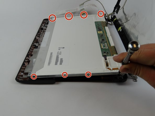 Remove the casing from the edges of the screen by removing the eight 2mm  screws with a JIS #000 screwdriver.