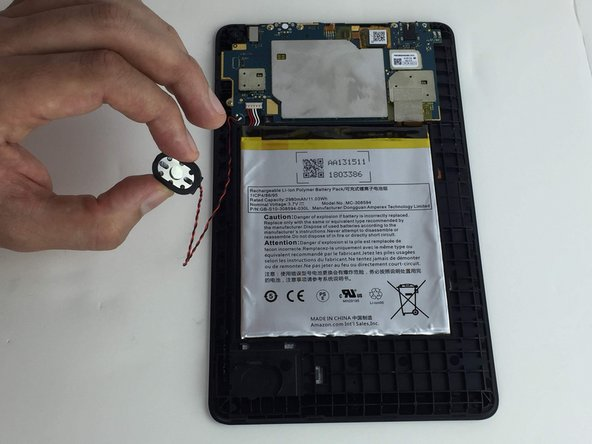 Lift the speaker up from the device to remove the speaker wires from their groove in the case.