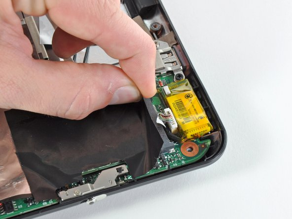If present, slightly peel back the large piece of black adhesive film covering the connector on the Bluetooth cable.