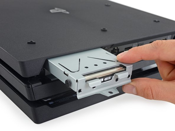 Image 1/1: Remove the four Phillips #0 screws securing the hard drive to the caddy.