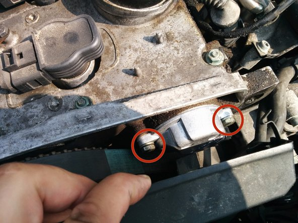 Now you should be able to pull the timing belt cover far enough towards the front of the car to access the sensor.