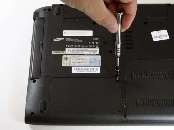 Remove both of the 5 mm Phillips head screws on the HDD back plate cover.
