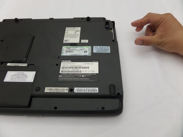 Image 2/2: The hard drive may not slide out easily, and may require a little bit of force in order to be disconnected from the laptop.