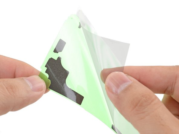 Peel the clear liner off of the support adhesive strip to expose the adhesive.