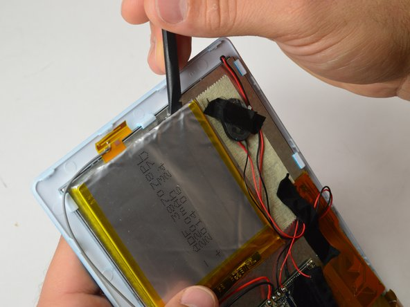 Using the Spudger, going between the battery and screen, pry the battery off from the tablet.