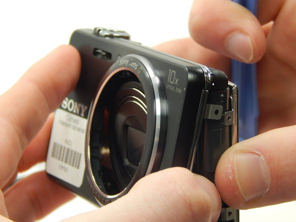Use the plastic opening tool to gently remove the front and back plates of the camera.