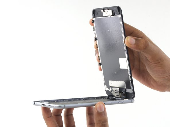 Open the display to about a 90º angle, and lean it against something to keep it propped up while you're working on the phone.