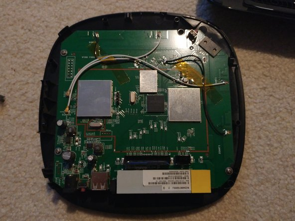 Once all the screws are unscrewed from the base, remove the main cover for the router.